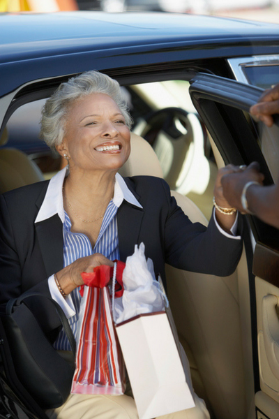 Image of smiling woman using local medical transportation services